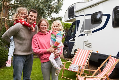Family outside of RV